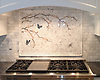 This custom handmade mosaic backsplash features a Plum Blossom with Butterflies, shown in Calacatta Tia, Driftwood, Rosa Portagallo, Blue Bahia, Blue Macauba, and Lavender Mist.<br />