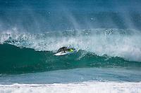 MICK FANNING (AUS) surfing the Superbank, Coolangatta, Queensland, Australia during swell generated by Cyclone Jasper.  Photo: joliphotos.com