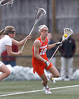 Syracuse University midfielder Katie Webster (18) brings the ball forward.   Syracuse University (orange) defeated Boston College (white), 17-12, on the Newton Campus Lacrosse Field at Boston College, on March 27, 2013.