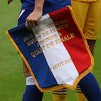 Women's Olympic Football match France v Sweden on 3.8.12...Sandrine Soubeyrand, Captain of France with the pennant for exchanging before the Women's Olympic Football match between France v Sweden at Hampden Park, Glasgow...............
