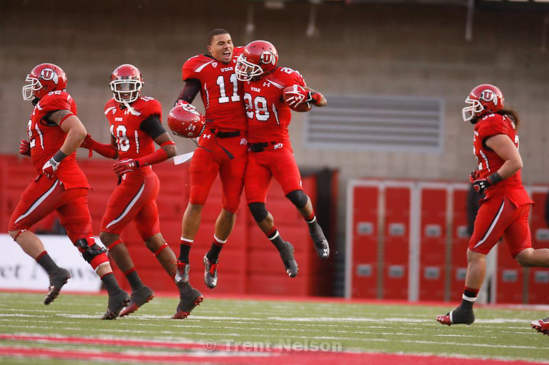 Trent Nelson  |  The Salt Lake Tribune.Utah's Luke Matthews (11) and Reggie Topps (28) celebrate Topps' fourth quarter interception, Utah vs. Colorado, college football at Rice-Eccles Stadium in Salt Lake City, Utah, Friday, November 25, 2011. Colorado wins 17-14.