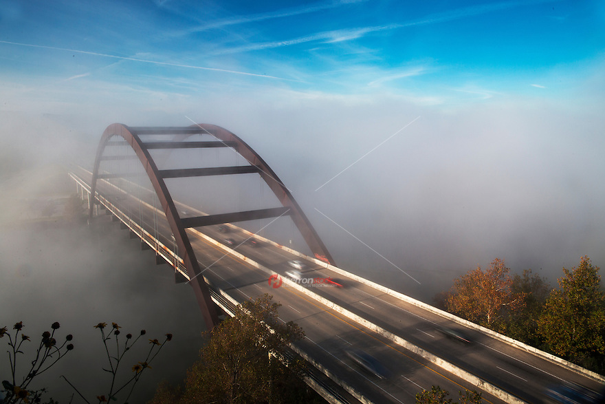 A Foggy morning paints the 360 Bridge on Lake Austin during sunrise on a cold winter's morning.