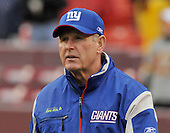 Landover, MD - November 30, 2008 -- New York Giants head coach Tom Coughlin walks on the field to watch warm-ups prior to the game against the Washington Redskins at FedEx Field in Landover, Maryland on Sunday, November 30, 2008..Credit: Ron Sachs / CNP.(RESTRICTION: No New York Metro or other Newspapers within a 75 mile radius of New York City)