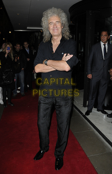 BRIAN MAY.Freddie For A Day charity gala arrivals, Savoy hotel, the Strand, London, England..September 5th, 2011.full length black shirt arms crossed jeans denim.CAP/CAN.©Can Nguyen/Capital Pictures.