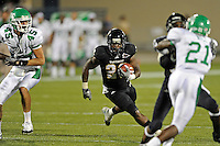 1 September 2011:  FIU's Darriet Perry (28) carries the ball in the second half as the FIU Golden Panthers defeated the University of North Texas, 41-16, at University Park Stadium in Miami, Florida.
