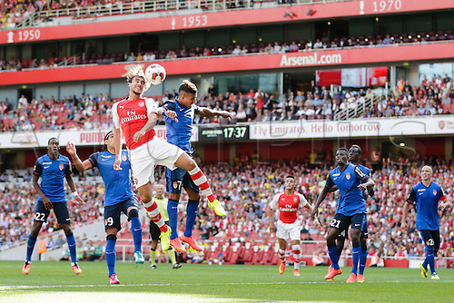03.08.2014. London, England. Emirates Cup.  Arsenal versus AS Monaco.   Arsenal's Ignasi MIQUEL wins a header in the box  With Monaco winning 0-1 and Valencia winning earlier in the day, Valencia won the tournament trophy.
