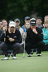 Padraig Harrington and Miguel Angel Jimenez line up their putts on the 6th green during the 3rd round of the BMW PGA Championship at Wentworth Club, Surrey, England 26th may 2007 (Photo by Eoin Clarke/NEWSFILE)