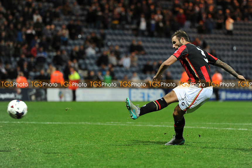 Steve Cook of Bournemouth scores his penalty in the shootout during Preston North End vs AFC Bournemouth at Deepdale