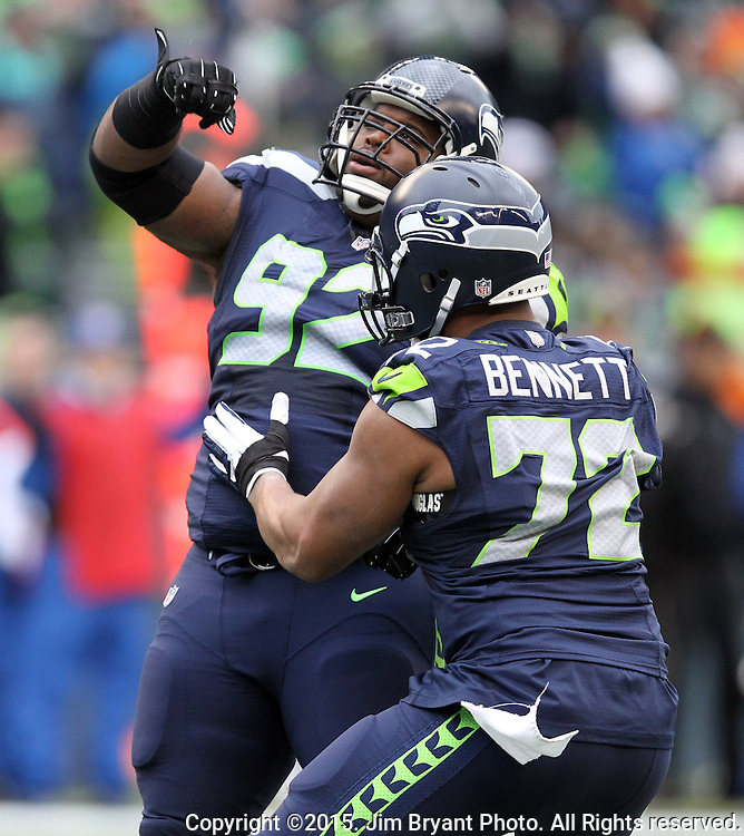 Seattle Seahawks defensive tackle Brandon Mebane (92) celebrates with defensive end Michael Bennett (72) after sacking Cleveland Browns quarterback Johnny Manizel (2) at CenturyLink Field in Seattle, Washington on December 20, 2015. The Seahawks clinched their fourth straight playoff berth in four seasons by beating the Browns 30-13.  ©2015. Jim Bryant Photo. All Rights Reserved.