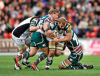 Leicester, England. Chris Robshaw (Captain) of Harlequins tackled during the Aviva Premiership match between Leicester Tigers and Harlequins at Welford Road on September 22, 2012 in Leicester, England.