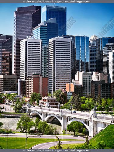 Centre Street Bridge and Calgary city downtown towers daytime urban scenery. Calgary, Alberta, Canada 2017.