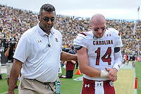 September 28, 2013 - Orlando, FL, U.S: South Carolina Gamecocks quarterback Connor Shaw (14) is escorted of the field by a trainer with an injured shoulder during 1st half NCAA football game action between the South Carolina Gamecocks and the UCF Knights at Bright House Networks Stadium in Orlando, Fl