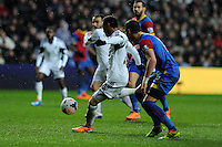 Swansea city's Jonathan De Guzman shoots and scores his sides 1st goal. Barclays Premier league, Swansea city v Crystal Palace match at the Liberty Stadium in Swansea, South Wales on Sunday 2nd March 2014.