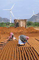 INDIA Tamil Nadu Muppandal, large wind farm with wind turbines and women work at brick industry unit at Cape Comorin | INDIEN Tamil Nadu , Frauen arbeiten in Ziegelei vor Windpark am Kap Comorin