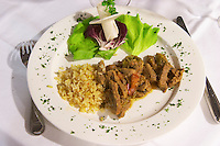 Beef goulash with rice and salad. At the rooftop restaurant Biosphere. Historic town of Mostar. Federation Bosne i Hercegovine. Bosnia Herzegovina, Europe.