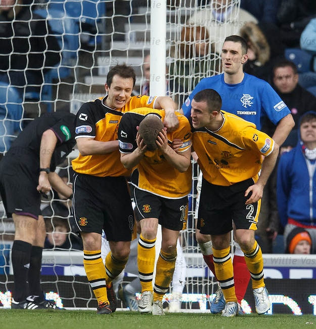 David Hopkirk is congratulated on hia goal as Lee Wallace looks dumbfounded