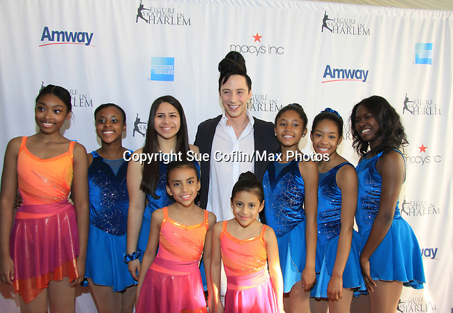American Figure Skater Johnny Weir poses with skaters at The 2013 Skating with the Stars- a benefit gala for Figure Skating in Harlem on April 8, 2013 at Trump Wollman Rink, New York City, New York. (Photo by Sue Coflin/Max Photos)