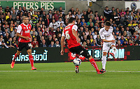Pictured: Josh Sheehan of Swansea (R) takes a shot past Richard Wood of Rotherham (C). Tuesday 26 August 2014<br /> Re: Capital One Cup, Swansea City FC v Rotherham at the Liberty Stadium, south Wales