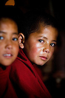 Young monks sit waiting for the special prayers to start at Thiksay Monastery, Leh, Ladakh, Jammu & Kashmir, India, on the morning of 1st June 2009. Thiksay, founded in the 15th century, sits on a hill 19 km southeast of Leh town, and houses approximately 100 monks. Photo by Suzanne Lee