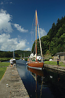 A yacht passing through the locks at Cairnbaan on the Crinan Canal, Argyll & Bute<br /> <br /> Copyright www.scottishhorizons.co.uk/Keith Fergus 2011 All Rights Reserved