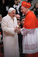 Cardinal and Vatican Secretary of State Pietro Parolin   is congratulated by Pope emeritus Benedict XVI  after he was appointed cardinal by the Pope at the consistory in the St. Peter's Basilica at the Vatican on February 22, 2014.