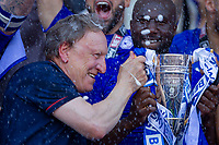 Neil Wanock is sprayed with champagne as he holds the Championship runners up trophy after the Sky Bet Championship match between Cardiff City and Reading at the Cardiff City Stadium, Cardiff, Wales on 6 May 2018. Photo by Mark  Hawkins / PRiME Media Images.