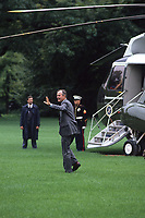 Washington DC., USA,  1990<br /> President George H.W. Bush. waves to crowd as he walks towards Marine One on the South Lawn of the  White House for a trip to Camp David. Credit: Mark Reinstein/MediaPunch