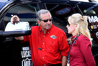 Sept. 14, 2012; Concord, NC, USA: NHRA team owner Don Schumacher talks with Julie Moser during qualifying for the O'Reilly Auto Parts Nationals at zMax Dragway. Mandatory Credit: Mark J. Rebilas-