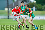 In Action E. Kerry's Dean Fitzgerald and M. Kerry's Gavin Horan and Gavin McKenna in the Acorn Life Under 21 Football Championship seemi Finals East Kerry V Mid Kerry in Austin Stack Park on Thursday