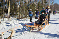 Sony Lindner and team run past spectators on the bike/ski trail during the Anchorage ceremonial start during the 2014 Iditarod race.<br /> Photo by Britt Coon/IditarodPhotos.com