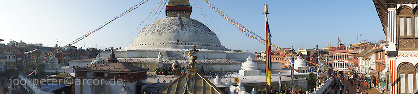 panorama Boudha stupa with street scene, Boudhanath,  Kathmandu, Nepal - Boudhanath near Kathmandu is one of the most holy places of buddhist worship and pilgrimage. The ancient Stupa is one of the largest in the world.
