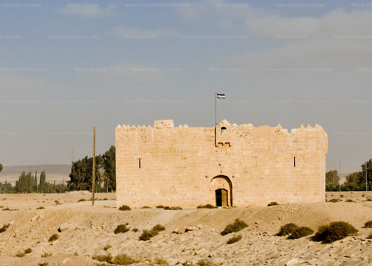 "An old desert fort, now used by the Jordanian Army, stands near the ""desert highway"" south of Amman, Jordan.  © Rick Collier"