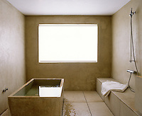 This minimal bathroom is completely constructed of concrete, including the bath tub