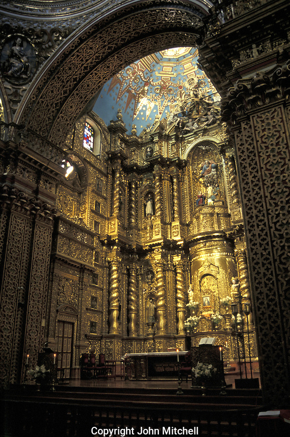 The main altar of La Compania de Jesus church in old Quito, Ecuador. This Jesuit church is an  examples of the 'Baroque school of Quito', which is a fusion of Spanish, Italian, Moorish, Flemish and indigenous art. Old Quito was a made a UNESCO World Heritage Site in 1978.