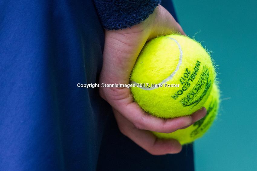 London, England, 7 th July, 2017, Tennis,  Wimbledon, ballboy holding Wimbledon tennis balls <br /> Photo: Henk Koster/tennisimages.com