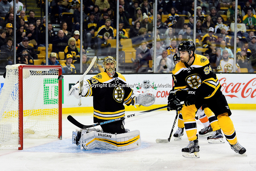 Tuesday, December 20, 2016: Boston Bruins goalie Tuukka Rask (40) and .defenseman Adam McQuaid (54) watch a puck go wide of the net during the National Hockey League game between the New York Islanders and the Boston Bruins held at TD Garden, in Boston, Mass. The Islanders defeat the Bruins 4-2. Eric Canha/CSM