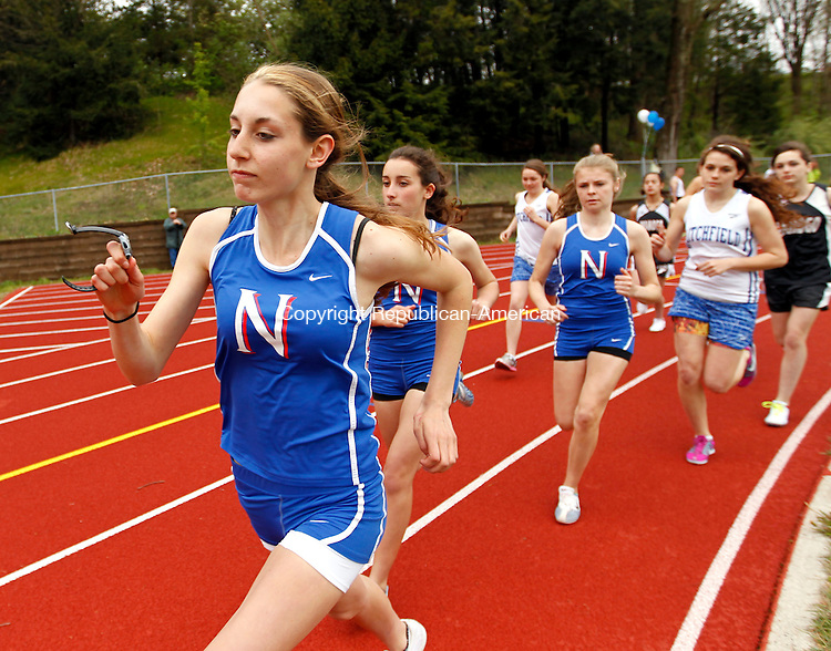 Woodbury, CT-01 May 2012-050112CM04- Nonnewaug's Bridget Nicholas takes the lead at the start of the 1600m Tuesday afternoon at Nonnewaug High School in Woodbury.  Nicholas wouldn't relinquish her position and would go onto win in 5:43.    Christopher Massa Republican-American