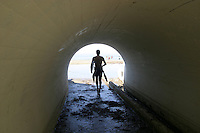 Surfer In Tunnel At Riviera Beach San Clemente