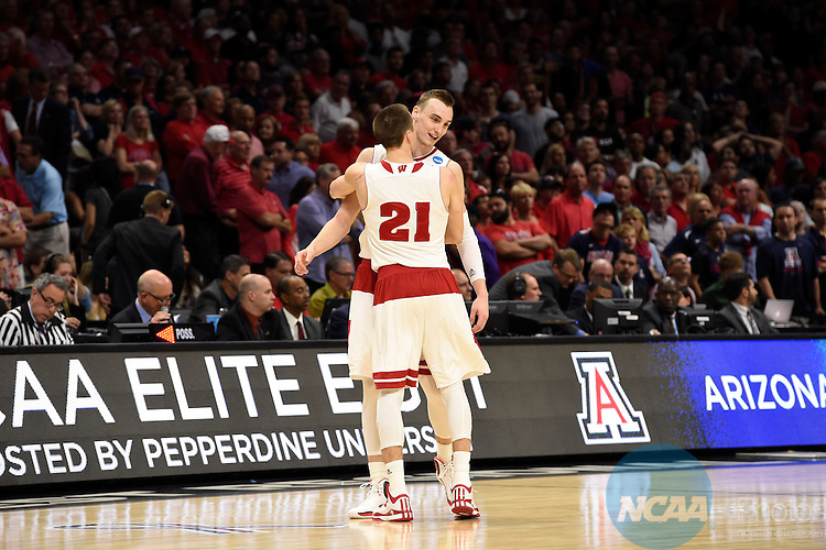 28 MAR 2015:  Sam Dekker (15) and Josh Gasser (21) of the University of Wisconsin celebrate their victory over the University of Arizona during the 2015 NCAA Men's Basketball Tournament held at the Staples Center in Los Angeles, CA.  Wisconsin defeated Arizona 85-78 to advance to the Final Four.  Jamie Schwaberow/NCAA Photos