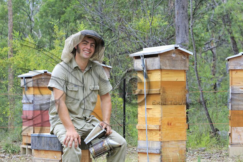 Portrait of Tim Malfroy at an apiary of Warré hives.///Portrait de Tim Malfroy sur un rucher de ruches warré.