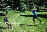 Owner of Rocky Mountain Slackline Dakota Collins (left), works with The Adventurist columnist, Clint Carter at Spring Park in Ft. Collins, Colorado, Sunday, August 27, 2017. Carter take on a vertigo-inducing highline&nbsp;that stretches across a traverse after only 4 days of training.<br /> <br /> Photo by Matt Nager