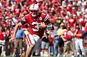 11 September 2010: Nebraska quarterback Taylor Martinez (3) running the ball on a keeper play against Idaho at Memorial Stadium in Lincoln, Nebraska. Nebraska defeated Idaho 38 to 17.
