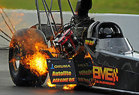 Jun. 18, 2011; Bristol, TN, USA: NHRA top fuel dragster driver Troy Buff blows an engine during qualifying for the Thunder Valley Nationals at Bristol Dragway. Mandatory Credit: Mark J. Rebilas-