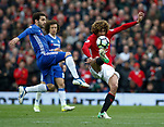 Cesc Fabregas of Chelsea in action with Marouane Fellaini of Manchester United during the English Premier League match at Old Trafford Stadium, Manchester. Picture date: April 16th 2017. Pic credit should read: Simon Bellis/Sportimage