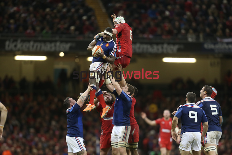 French flanker Yannick Nyanga beats Wales lock Jake Ball to the line out ball.<br /> RBS 6 Nations 2014<br /> Wales v France<br /> Millennium Stadium<br /> 21.02.14<br /> <br /> ©Steve Pope-SPORTINGWALES