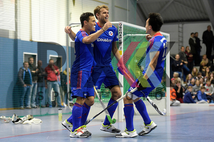 GER - Mannheim, Germany, January 10: During the 1. Bundesliga Sued Herren indoor hockey match between TSV Mannheim (red) and Mannheimer HC (blue) on January 10, 2016 at TSV Mannheim in Mannheim, Germany.  (L-R) Patrick Harris #17 of Mannheimer HC, Florian Woesch #25 of Mannheimer HC, Danny Nguyen Luong #22 of Mannheimer HC<br /> <br /> Foto &copy; PIX-Sportfotos *** Foto ist honorarpflichtig! *** Auf Anfrage in hoeherer Qualitaet/Aufloesung. Belegexemplar erbeten. Veroeffentlichung ausschliesslich fuer journalistisch-publizistische Zwecke. For editorial use only.