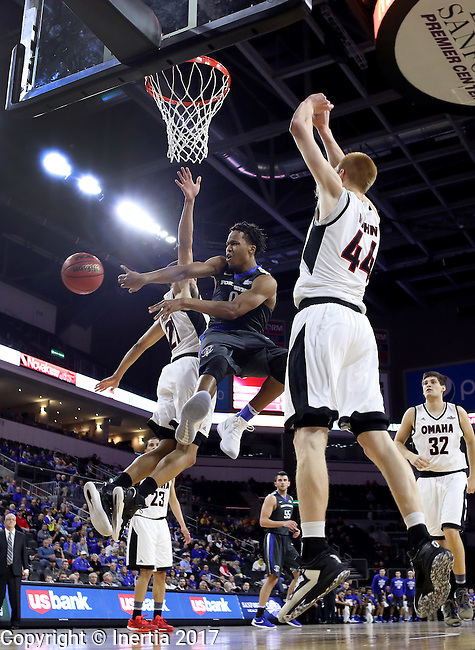 SIOUX FALLS, SD: MARCH 5: Mo Evans #0 of IPFW dishes off between Omaha defenders Zach Jackson #21 and Mitch Hahn #44 during the Summit League Basketball Championship on March 5, 2017 at the Denny Sanford Premier Center in Sioux Falls, SD. (Photo by Dick Carlson/Inertia)