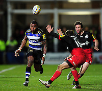 Semesa Rokoduguni of Bath Rugby puts boot to ball. Aviva Premiership match, between Bath Rugby and Saracens on April 1, 2016 at the Recreation Ground in Bath, England. Photo by: Patrick Khachfe / Onside Images