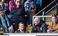 Former Swindon Town Manager Mark Cooper (front Row, Left) watches from the stands during the Sky Bet League 2 match between Wycombe Wanderers and Stevenage at Adams Park, High Wycombe, England on 12 March 2016. Photo by Andy Rowland/PRiME Media Images.