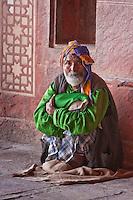 Fatehpur Sikri, Uttar Pradesh, India.  Man Sitting in the Prayer Hall of the Jama Masjid (Dargah Mosque).